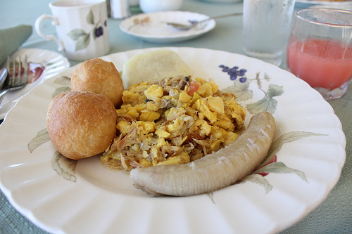 Ackee and Saltfish breakfast with green banana and fried dumplings.